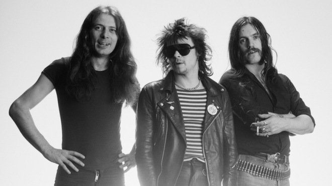 Motorhead (from left: guitarist Eddie Clarke, drummer Phil Taylor, and singer and bassist Lemmy Kilmister), British heavy metal band, pose for a group studio portrait, against a white background, circa 1978. (Photo by Fin Costello/Redferns/Getty Images)